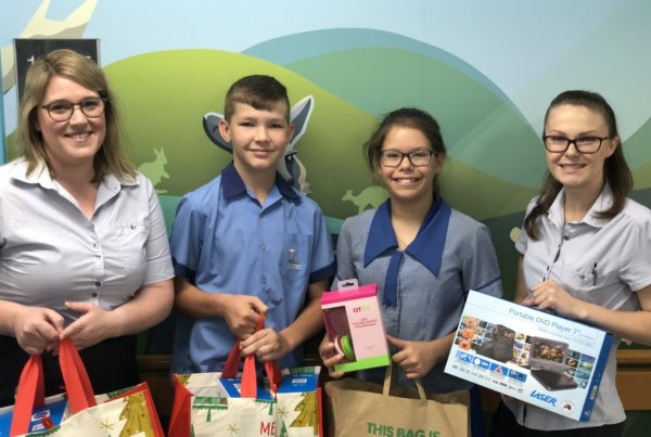 Students from Peace Primary donating gifts to the sunshine ward