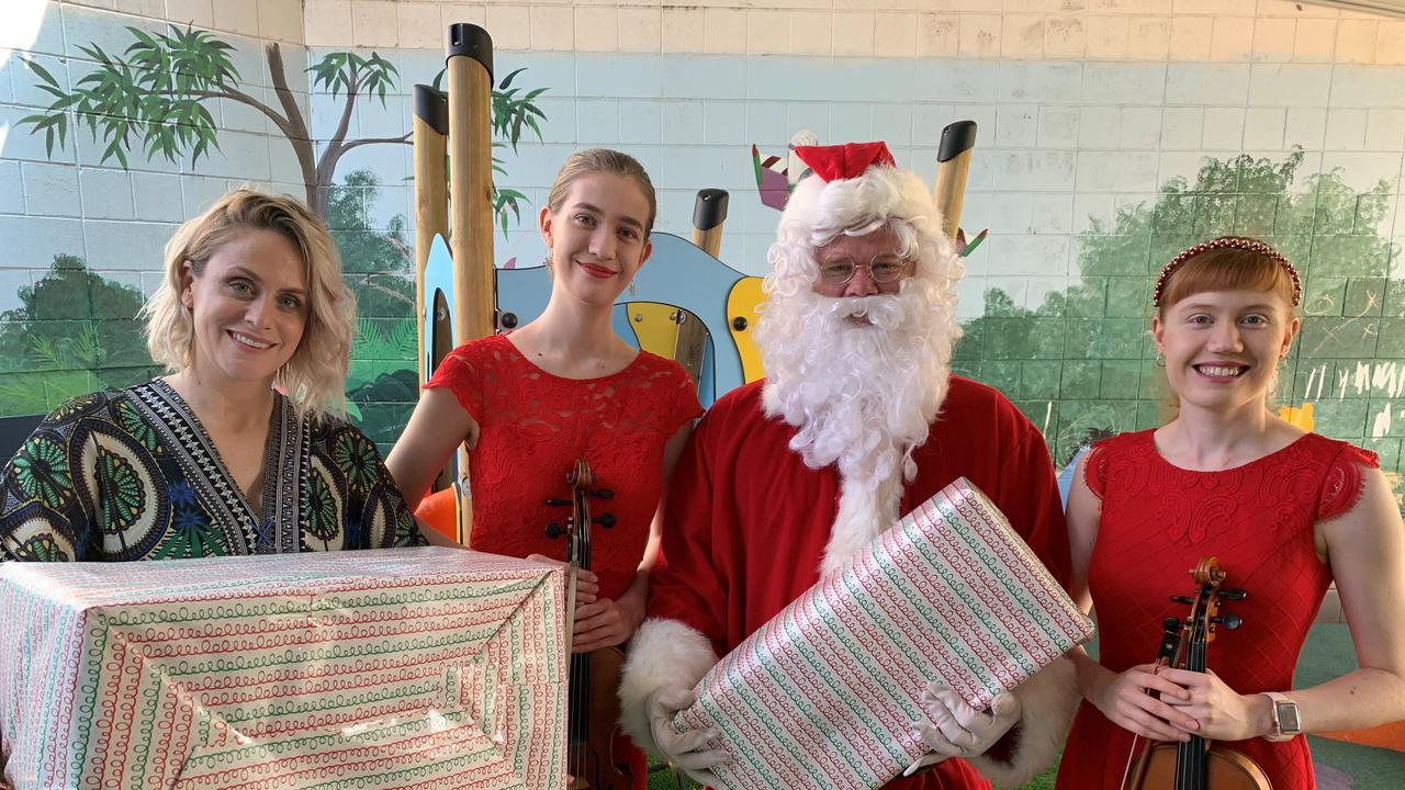 Lisa donating toys with Santa