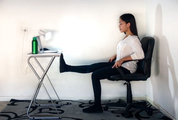 Desk exercise with a leg extension