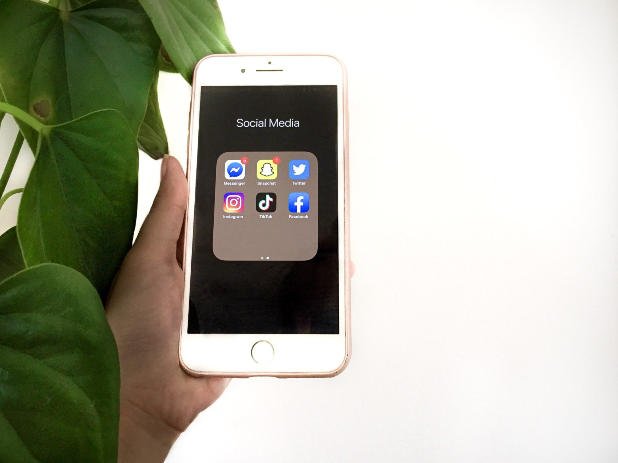Holding a phone with social media apps