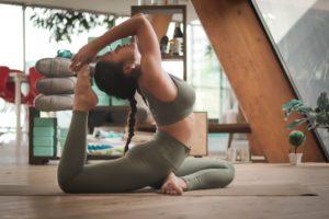 Woman in a loft doing yoga
