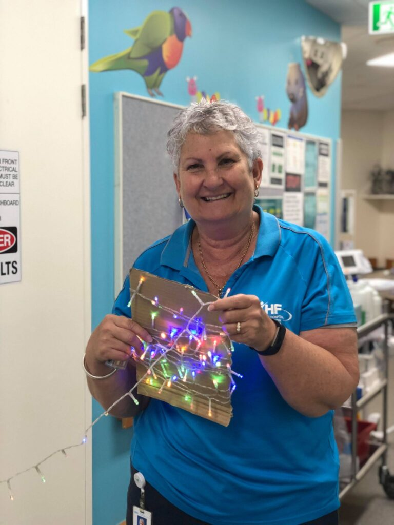 Volunteer, Joanne decorating the wards with Christmas Lights